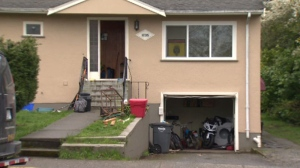 An emergency response team swarmed a home on Cedar Hill Cross Road, breaking down the door and arresting two men without incident Tuesday, March 28, 2017. (CTV Vancouver Island)