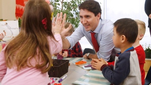Prime Minister Justin Trudeau meets with children at a YMCA-YWCA day care centre in Winnipeg, Wednesday, March 29, 2017. Trudeau was in Winnipeg to highlight their plan to spend $7 billion over 10 years to create more child care spaces across Canada. (THE CANADIAN PRESS/John Woods)