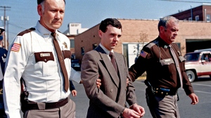 In this Nov. 2, 1987, file photo, convicted killer Donald Harvey, center, is led back to jail by Laurel County, Ky., Sheriff Floyd Brummett, left, and an unidentified deputy after pleading guilty to eight murder charges and one voluntary manslaughter charge in London, Ky. (AP Photo/Ed Reinke, File)