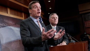 Senate Intelligence Committee Vice Chairman Sen. Mark Warner, D-Va., left, with Committee Chairman Sen. Richard Burr, R-N.C., speaks during a news conference on Capitol Hill in Washington, Wednesday, March 29, 2017. (AP Photo/J. Scott Applewhite)