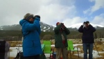 Bird watchers look for Golden Eagles above Kananaskis County, Alta., in March 2017.