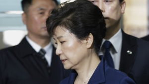 Ousted South Korean President Park Geun-hye, second from left, arrives at the Seoul Central District Court for hearing on a prosecutors' request for her arrest for corruption, in Seoul, South Korea on Thursday, March 30, 2017. (AP / Ahn Young-joon)