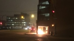 A fire burns at the entrance to Kilborn Place in downtown Saskatoon on Thursday, March 30, 2017, moments before an explosion. (Logan Tufts)