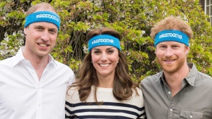 Undated handout photo of Prince William, left, Kate Duchess of Cambridge and Prince Harry wearing charity headbands issued by The Royal Foundation of the Duke and Duchess of Cambridge and Price Harry. The three royals are spearheading a campaign to encourage people to talk openly about mental health issues. (The Royal Foundation of the Duke and Duchess of Cambridge and Price Harry via AP)