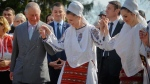 Prince Charles, left, joins a traditional folk dance in Bucharest, Romania, Thursday, March 30, 2017. (AP Photo/Andreea Alexandru)