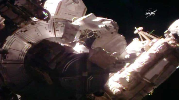 This still image taken from NASA shows NASA astronaut Peggy Whitson during a space walk at the International Space Station on Thursday, March 30, 2017. Whitson, the world's oldest and most experienced spacewoman has just set another record, her eighth spacewalk. (NASA via AP)