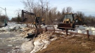 Municipal crews work to clear an ice jam that along Boundary Creek at Prospect Street that caused flooding in Winnipeg Beach on March 20, 2017. (Photo: Stephanie Tsicos/CTV Winnipeg)