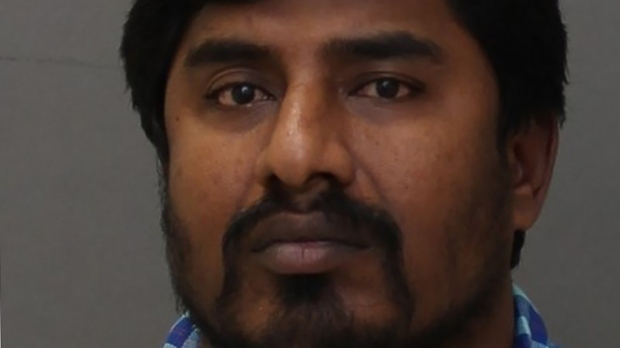 Murali Muthyalu, 37, has been charged with witchcraft, extortion and fraud.  (Toronto Police photo). The Canadian Press
