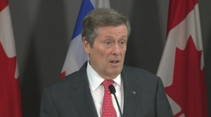 Mayor John Tory speaks with reporters at city hall on Thursday.
