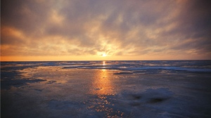 Sunset over the ice at Lake Manitoba