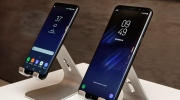 In this Friday, March 24, 2017, photo, new Samsung Galaxy S8, left, and Galaxy S8 Plus mobile phones are displayed in New York. The Galaxy S8 features a larger display than its predecessor, the Galaxy S7, and sports a voice assistant intended to rival Siri and Google Assistant. (AP Photo/Richard Drew)
