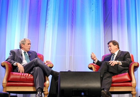 In this photo released by TinePublic, former U.S. President George W. Bush, left, speaks with former Canadian Ambassador to the United States Frank McKenna at an invitation-only event on Tuesday, March 17, 2009 in Calgary. (AP / TinePublic, Ewan Nicholson)