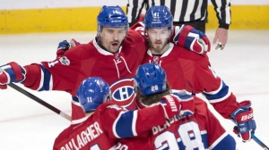 Montreal Canadiens left wing Paul Byron (41) celebrates with teammates Tomas Plekanec (14), Brendan Gallagher (11) and Nathan Beaulieu (28) on Thursday, March 30, 2017. THE CANADIAN PRESS/Ryan Remiorz
