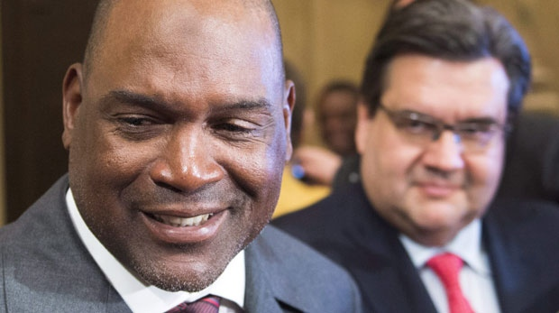 Former Montreal Expos great and Hall of Fame inductee Tim Raines, left, speaks to the media as Mayor Denis Coderre looks on after a ceremony in his honour at City Hall Friday, March 31, 2017 in Montreal. THE CANADIAN PRESS/Ryan Remiorz