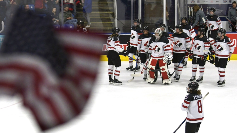 Canada players watch as players from the United States' team celebrate after beating Canada in their first meeting at the IIHF Ice Hockey Women's World Championship in Plymouth, Mich., on Friday, March 31, 2017. THE CANADIAN PRESS/Jason Kryk