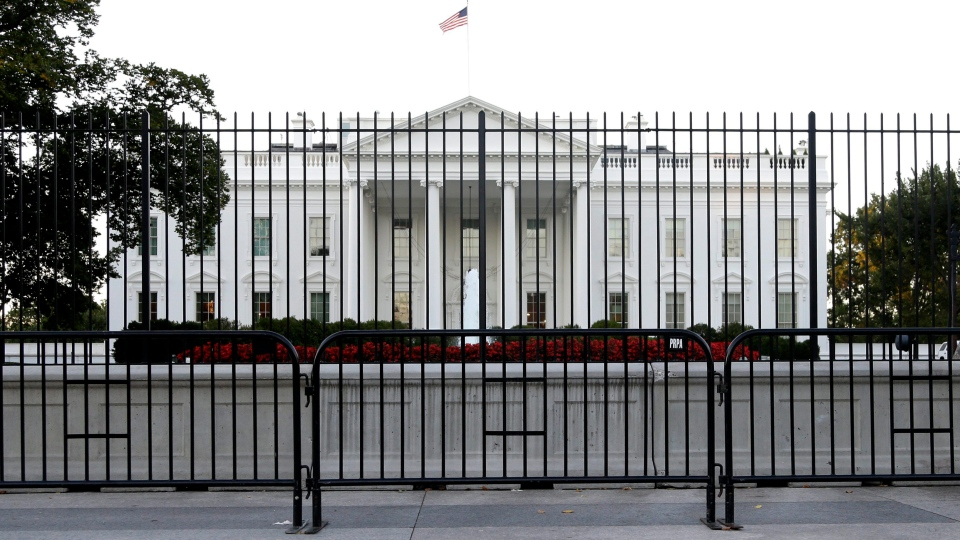 FILE - In this Sept. 22, 2014, file photo, the perimeter fence sits in front of the White House fence on the North Lawn along Pennsylvania Avenue in Washington. (AP Photo/Carolyn Kaster)