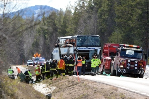 Emergency services and ambulance at the scene of a bus accident, on the E45 between Sveg and Fagelsjo in Sweden, Sunday, April 2, 2017. (Nisse Schmidt / TT via AP)