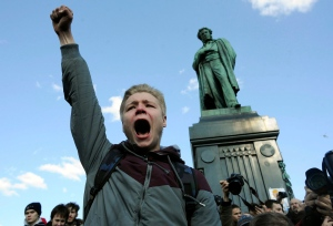 In this file photo, a demonstrator shouts anti-government slogans in downtown Moscow, Russia on Sunday, March 26, 2017. (AP / Andrew Lubimov)