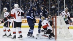 Winnipeg Jets' Blake Wheeler (26) and Mark Scheifele (55) celebrate Wheeler's goal against Ottawa Senators goalie Mike Condon (1) as Sens' Ryan Dzingel (18), Dion Phaneuf (2) and Chris Kelly (22) defend during second period NHL action in Winnipeg on Saturday, April 1, 2017. THE CANADIAN PRESS/John Woods