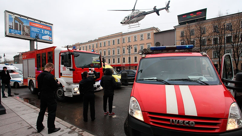 A helicopter flies over the fire trucks after an explosion at Tekhnologichesky Institut subway station in St.Petersburg, Russia, Monday, April 3, 2017. (Alexander Tarasenkov/Interpress via AP)