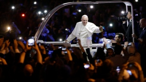 FILE - In this Sept. 26, 2015, file photo, Pope Francis waves to the crowd during a parade in Philadelphia. (AP Photo/Matt Rourke, Pool)