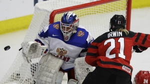 Russia goalie Maria Sorokina deflects a shot by Canada forward Haley Irwin during the first period of a IIHF Women's World Championship hockey tournament game in Plymouth, Mich. on Monday, April 3, 2017. (AP / Carlos Osorio)