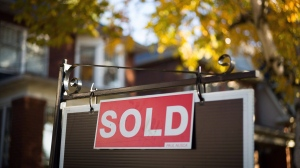 The hot real estate market in Toronto and the surrounding areas pushed home sales up 27.7 per cent in February compared with the same month a year ago. (Graeme Roy/The Canadian Press)