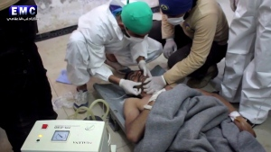 This frame grab from video provided on Tuesday April 4, 2017, by the Syrian anti-government activist group Edlib Media Center, that is consistent with independent AP reporting, shows a victim of a suspected chemical attack as he receives treatment at a makeshift hospital, in the town of Khan Sheikhoun, northern Idlib province, Syria. (Edlib Media Center, via AP)