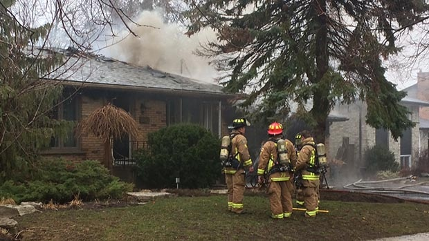 Firefighters can be seen at the scene of garage fire on Tower Crescent in Barrie, Ont. on Tuesday, April 4, 2017. (Steve Mansbridge/ CTV Barrie)
