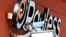 Sonny Garman, owner of All Season Signs, of Joplin, Mo., directs a crane operator as he installs the Payless Shoesource sign to the front of the store Thursday afternoon, Jan. 19, 2012, on Range Line Road in Joplin, Mo. (AP Photo/The Joplin Globe, T. Rob Brown)