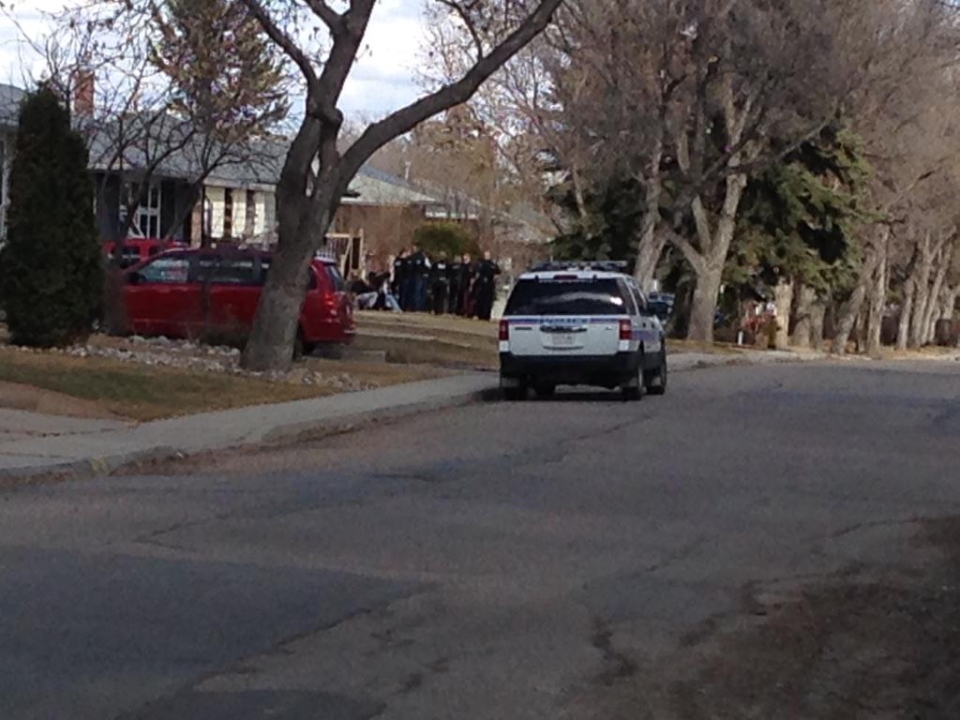 Several people were put in handcuffs after Regina police surrounded a home on Mullin Avenue on Tuesday, April 4, 2017. (DALE HUNTER/CTV REGINA)