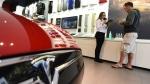 Telsa dealership (AFP PHOTO/ROBYN BECK)