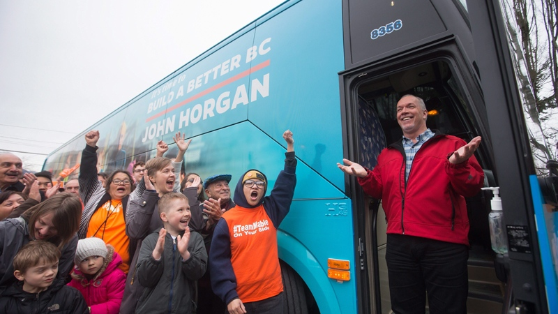 British Columbia NDP Leader John Horgan steps off his election campaign bus during an event to unveil it, in Burnaby, B.C., on Tuesday April 4, 2017. THE CANADIAN PRESS/Darryl Dyck