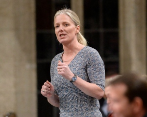 Minister of Environment and Climate Change Catherine McKenna rises during Question Period in the House of Commons on Parliament Hill, in Ottawa on Friday, March 24, 2017. (Justin Tang / THE CANADIAN PRESS)