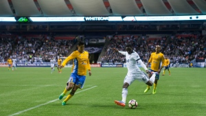 Vancouver Whitecaps' Alphonso Davies, right, takes a shot on goal as Tigres' Hugo Ayala defends during first half, second leg, CONCACAF Champions League soccer semifinal action in Vancouver, B.C., on Wednesday, April 5, 2017. (Darryl Dyck / on Wednesday, April 5, 2017)