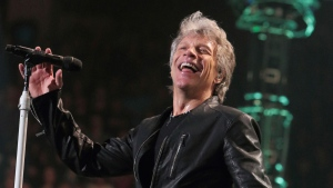 "In this Friday, March 31, 2017, file photo, Jon Bon Jovi of the band Bon Jovi performs in concert during their ""This House Is Not for Sale Tour"" at The Wells Fargo Center in Philadelphia. (Photo by Owen Sweeney/Invision/AP, File)"