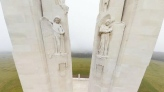 Angels  are shown near the top of the Canadian National Vimy Memorial, with Mother Canada framed between the pillars in the distance, in this image from Vimy, France. (Google Canada)