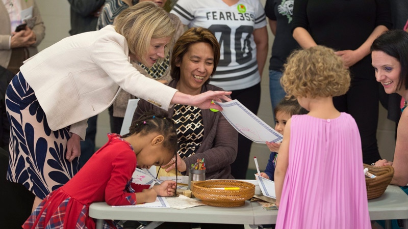 Premier Rachel Notley (far left) at Thursday's child care announcement with Children's Services Minister Danielle Larivee (far right). Supplied.