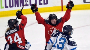 Canada's Blayre Turnbull (40) celebrates with teammate Natalie Spooner (24) after Turnbull scored a second period goal against Finland during the IIHF Ice Hockey Women's World Championship preliminary round game in Plymouth, Mich., on Saturday, April 1, 2017. (THE CANADIAN PRESS / Jason Kryk)