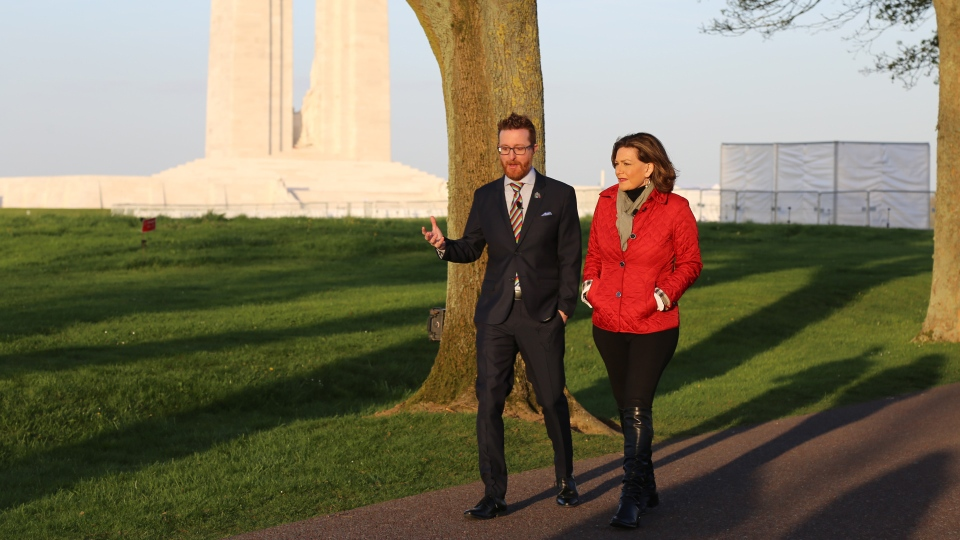 CTV National News Chief Anchor and Senior Editor Lisa LaFlamme walks with Jeremy Diamond, a historian and executive director of the Vimy Foundation, at the Canadian National Vimy Memorial in France.