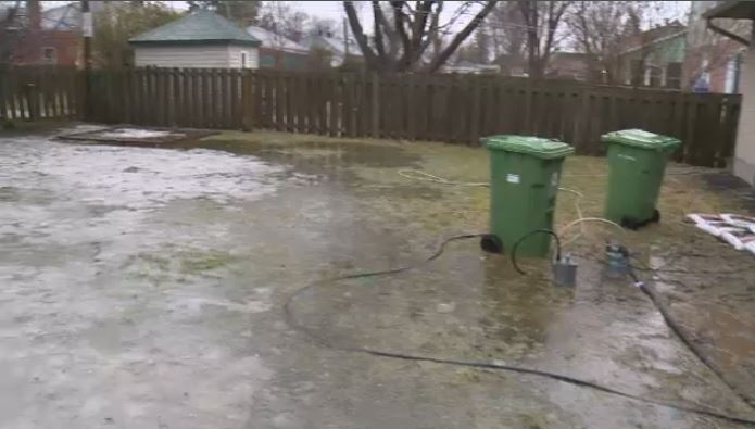 Dorval homeowners cope with flooded backyards as downpour ...