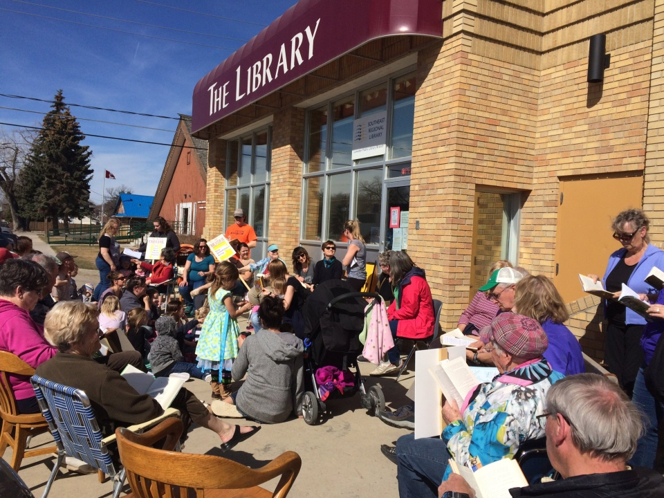 Demonstrator protest provincial cuts to public libraries during a rally outside a library in Lumsden, Sask. on Friday, April 7, 2017. (TAYLOR RATTRAY/CTV REGINA)
