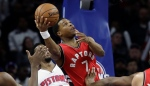 Toronto Raptors guard Kyle Lowry shoots during the first half of an NBA basketball game against the Detroit Pistons, Wednesday, April 5, 2017, in Auburn Hills, Mich. (AP Photo/Carlos Osorio)