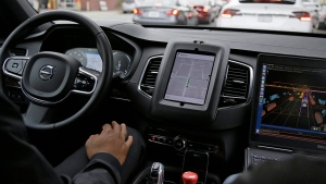 In this photo taken Tuesday, Dec. 13, 2016, an Uber driverless car waits in traffic during a test drive in San Francisco. (AP Photo / Eric Risberg)