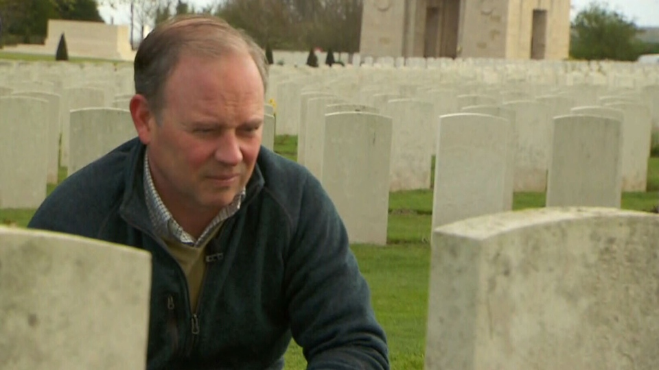 Todd Battis visits the grave of his great-grandfather, James Sydney Battis, at the Cabaret-Rouge cemetery in France.
