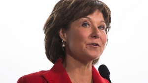 British Columbia Premier Christy Clark speaks while taking questions from reporters after addressing the Council of Forest Industries convention in Vancouver, B.C., on Friday April 7, 2017. THE CANADIAN PRESS/Darryl Dyck