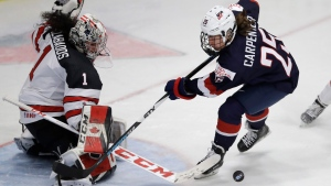 Canada goalie Shannon Szabados (1) stops a shot by U.S. forward Alex Carpenter (25) during the third period of the gold-medal game of the women's world hockey championships, Friday, April 7, 2017, in Plymouth, Mich. (AP Photo / Carlos Osorio)