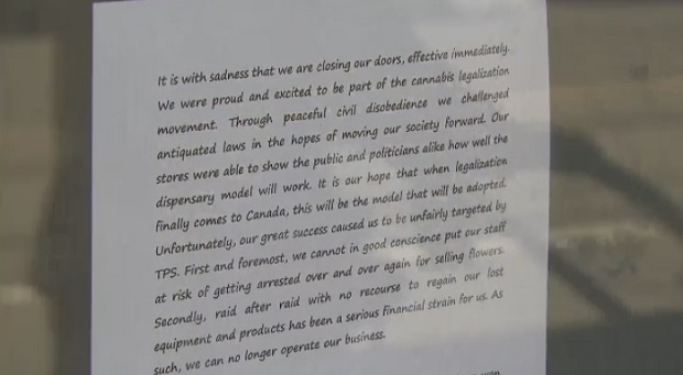 A letter posted on the door of a dispensary closing it's doors on Church Street is shown.
