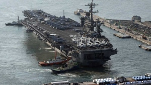 U.S. Navy aircraft carrier, the USS Carl Vinson approaches to participate in the annual joint military exercise called Foal Eagle between South Korea and the United States, at Busan port in Busan, South Korea on March 15, 2017. (Jo Jung-ho / Yonhap)
