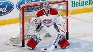 Montreal Canadiens goaltender Charlie Lindgren (40) warms up prior to an NHL hockey game against the Florida Panthers, Monday, April 3, 2017, in Sunrise, Fla. (AP Photo/Joel Auerbach)